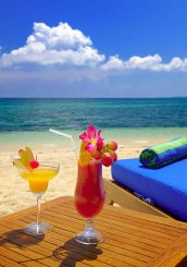 Relax on the beach with a cocktail at Siladen Resort.