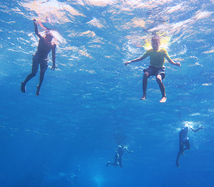 Curious kids from the village in Alor swam out to check out us snorkelers.