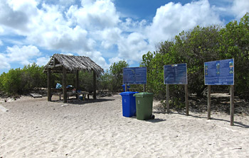 Shade Structures & Trash Cans On No Name Beach