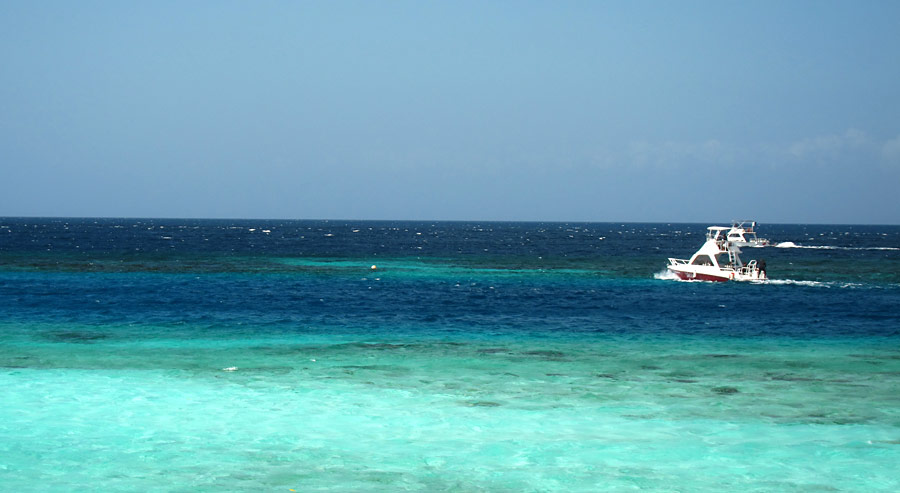 Boat Exiting Through Mangel Halto Reef Cut