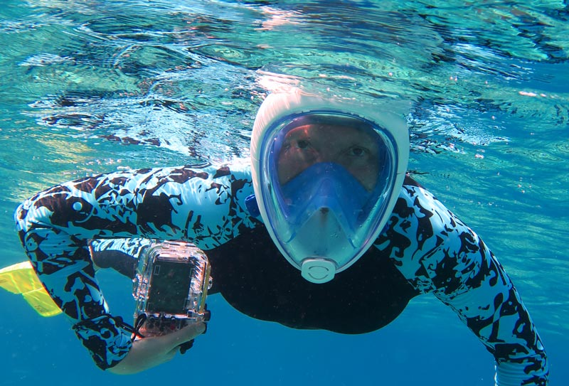 Nicole in a full face snorkel mask, the original Tribord Easybreath.