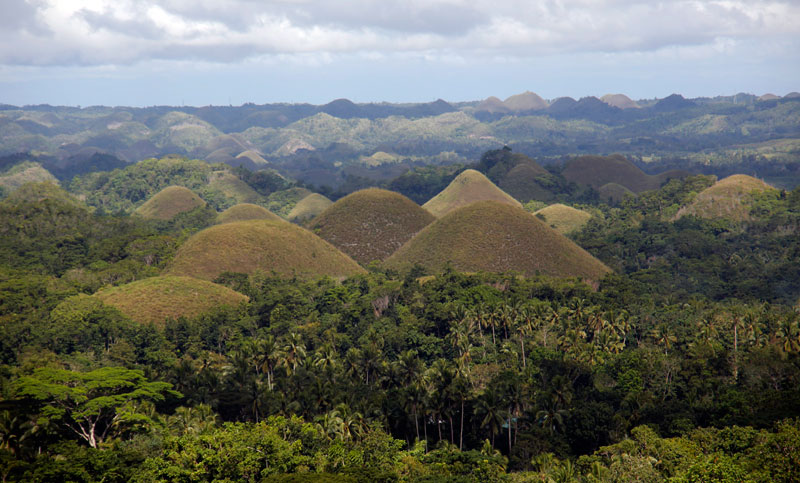 Visit the unique and beautiful Chocolate Hills of Bohol.
