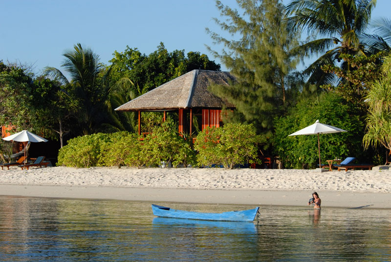 Snorkel the house reef from the beach in front of your Ocean Bungalow.