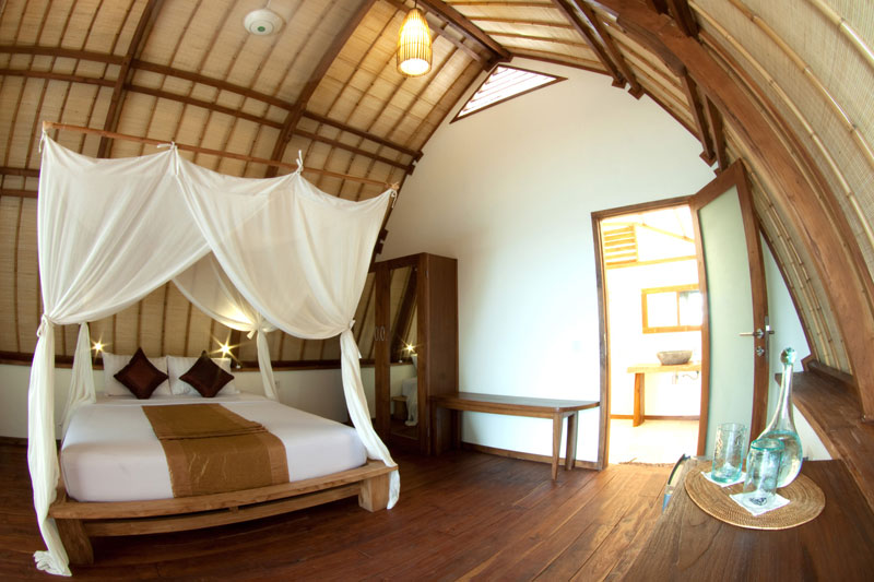 Well-appointed bungalows are right on the beach at Komodo Resort.