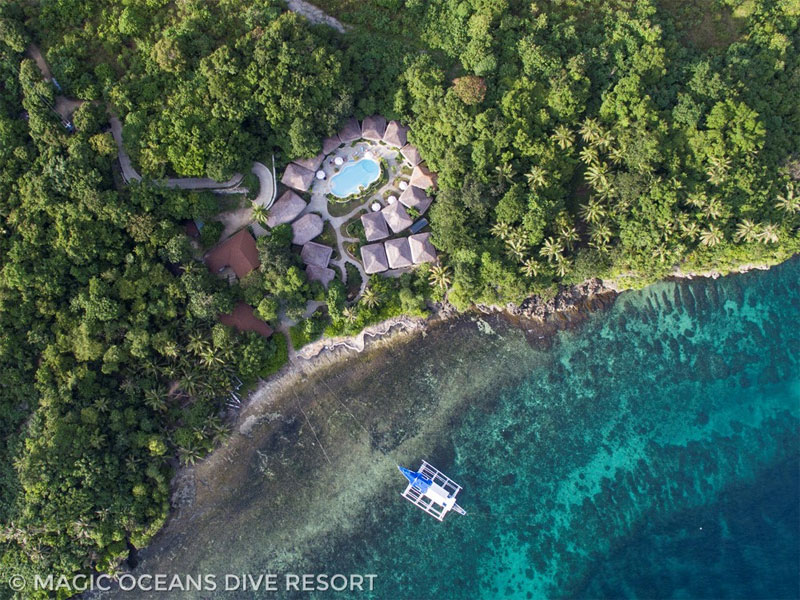 Aerial view of the Magic Oceans Resort and its stunning house reef.