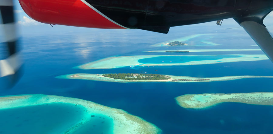The beautiful Maldives snorkeling resort, Vilamendhoo, from the sea plane.
