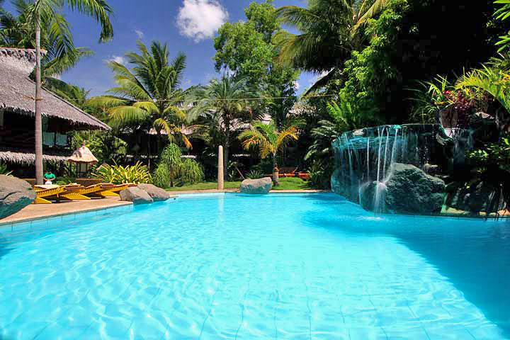 Relax at the pool at the Atlantis Dumaguete Resort the last day of your trip.