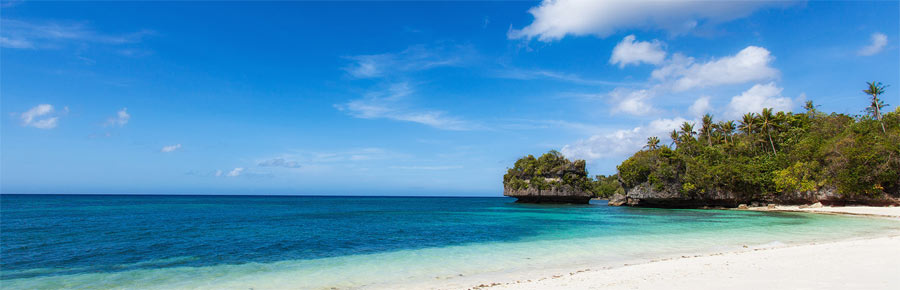 Amun Ini Resort's white sand beach is your home base for the Philippines portion of this snorkeling trip.