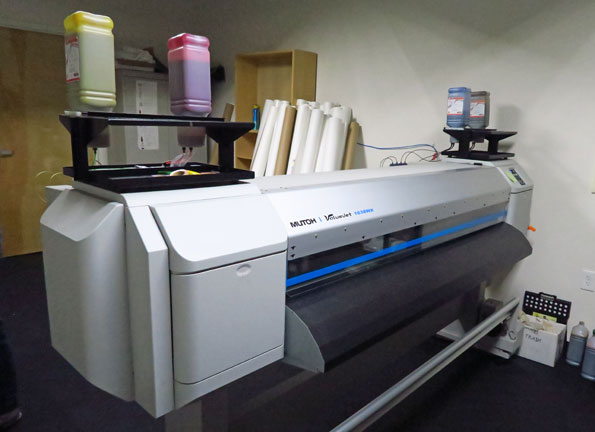 Dye Sub machine for printing photo realistic images on sun clothing.