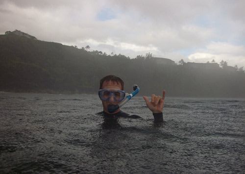 Galen snorkeling in the downpour at Sea Turtle Mecca