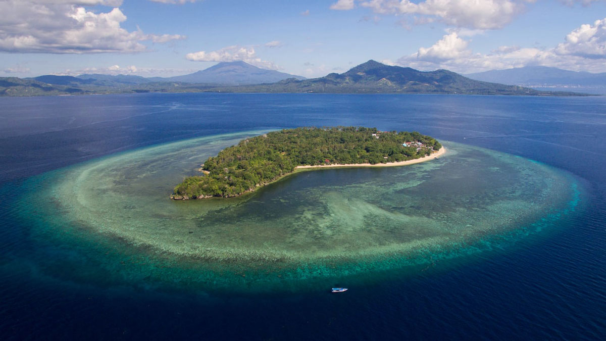 Siladen Island, home of the Siladen Resort, one stop on this amazing snorkeling safari.