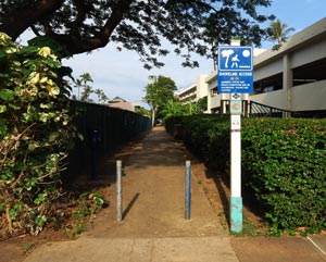 Walking path to Ka'anapali Beach for snorkeling Black Rock; marked by blue shoreline access sign No. 213.