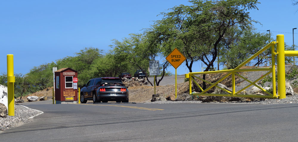The entry gate for parking at Hapuna Beach. There is a $5 parking fee for non-residents and it is open from 7 a.m. to 8 p.m.