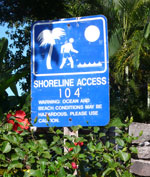 South parking lot at Makena Surf Condos, marked with blue shoreline access sign 104.