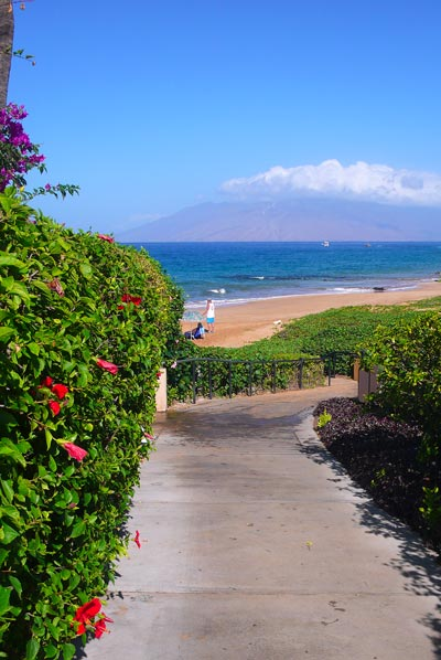 Cement path through Makena Surf Condos property. Gorgeous view!