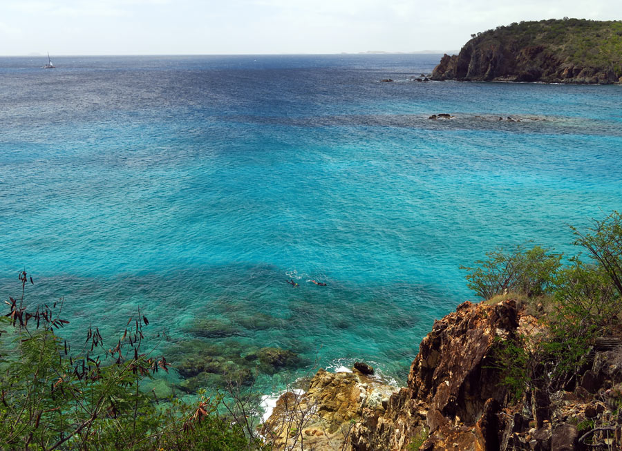 The best snorkeling area at Salt Pond Bay, the left point and the two rock islands in the middle.