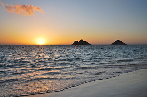 View of Na Mokulua from Lanikai Beach at sunrise.