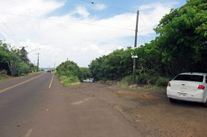 Koloa Landing upper parking area and turn down to the water.