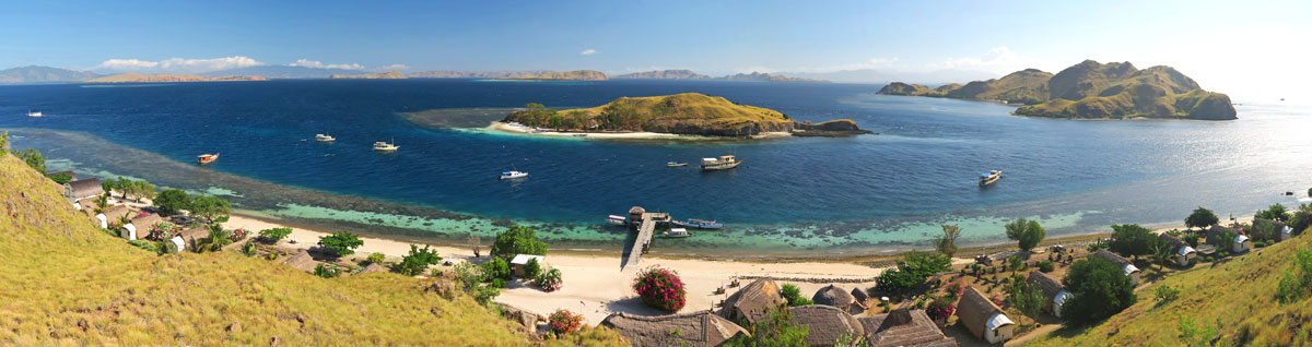 Click here to see this panorama of the Komodo Resort, beach and house reef larger.