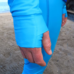 Thumb hole cuffs on the Tuga snorkel line rash guards protect your hands from the sun too.