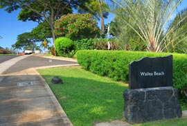 Black stone sign on the road marking Wailea Beach