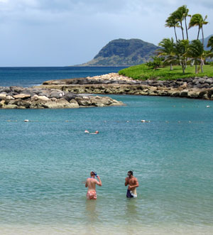 Snorkelers getting ready to explore the cuts in the rocky ocean barrier for snorkeling Ko Olina Lagoons