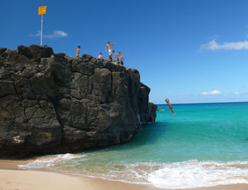 Jumping off the rock at Waimea Bay